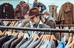 Man Shopping Among Very Similar Clothing